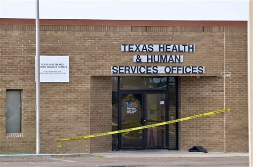 Crime Scene tape is posted at the main entrance to the Texas Health and Human Services Offices in Laredo, Texas, Tuesday, Dec., 6, 2011.