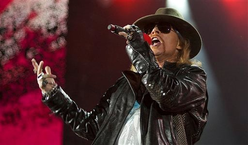 """FILE - In this Dec. 16, 2010 file photo, Axl Rose, lead singer of the rock band, """"Guns N' Roses,"""" performs during a concert on the Yas Island in Abu Dhabi, United Arab Emirates."""