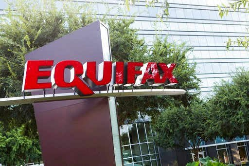 Photo shows signage at the corporate headquarters of Equifax Inc. in Atlanta.