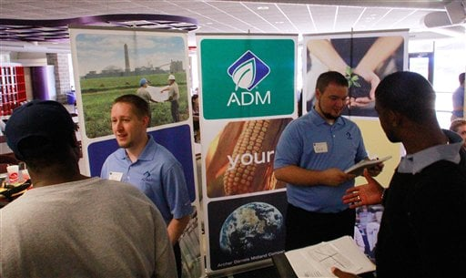 In this Sept. 1, 2011 photo, Archer Daniels Midland Company employees answer questions and hand out job applications during a job fair at the University of Illinois Springfield campus, in Springfield, Ill. (AP Photo/Seth Perlman)
