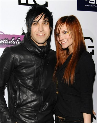 FILE - In this Jan. 30, 2008 file photo, singer Ashlee Simpson and rocker Pete Wentz arrive at Myst night club in Scottsdale, Ariz. Court records show a judge finalized their divorce on Nov. 22 in Los Angeles, but the former couple are keeping the exact.