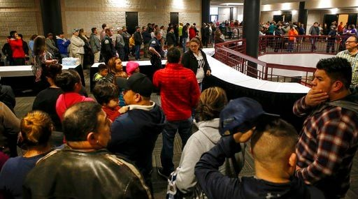 People lineup inside the Dalton Convention Center to pick up their children on Wednesday, Feb. 28, 2018 in Dalton, Ga.