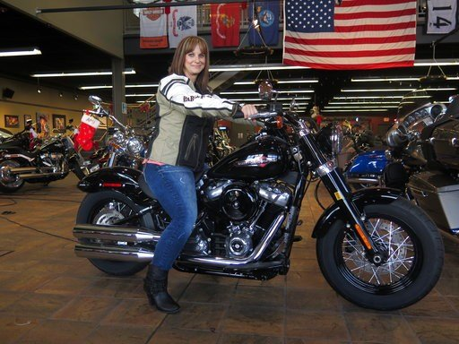 In this Dec. 12, 2017, photo, Terri Meehan poses on a 2018 Harley Softail Slim in Milwaukee's House of Harley.