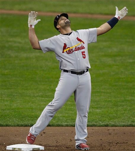 In this Oct. 10, 2011 file photo, St. Louis Cardinals' Albert Pujols reacts after hitting a two RBI double during the third inning of Game 2 of baseball's National League championship series against the Milwaukee Brewers, in Milwaukee.
