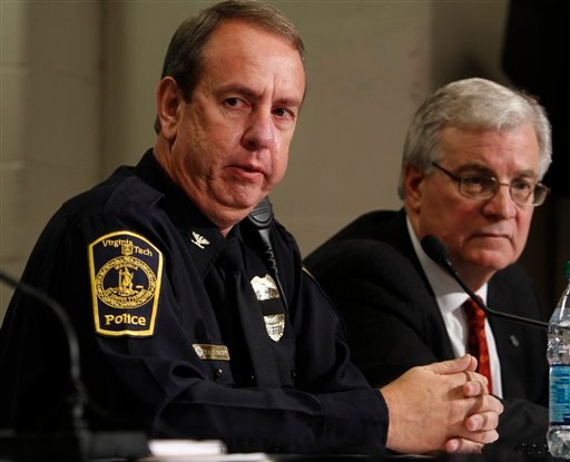 Virginia Tech police Chief Wendell Flinchum, left, speaks during a news conference as Virginia Tech Associate Vice President for University Relations Larry Hinker, right, listens Dec. 9, 2011. (AP Photo/Steve Helber)
