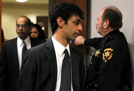 Dharun Ravi, former Rutgers student accused of using a webcam to spy on his roommate's intimate encounter with another man , leaves Middlesex County Court on Friday, Dec. 9, 2011 in New Brunswick, N.J. (AP Photo/Noah K. Murray, Pool)