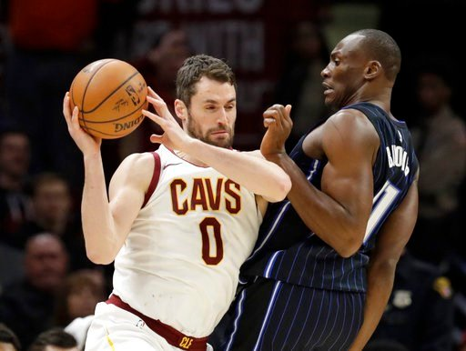 Cleveland Cavaliers' Kevin Love (0) drives past Orlando Magic's Jonathon Simmons (17) during the second half of an NBA basketball game Thursday, Jan. 18, 2018, in Cleveland.