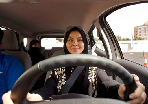 A student at the female-only campus of Effat University, sits for the first time in the driver's seat, during training sponsored by Ford Motor, in Jiddah, Saudi Arabia, Tuesday, March 6, 2018. (AP Photo/Amr Nabil)