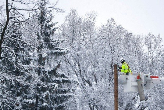 Phil Blair, a utility worker with PotomacEdison out of West Virginia, works on setting up a new power line.