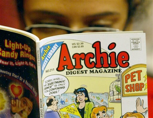 In this Monday, May 7, 2007, file photo, a girl reads an Archie comic at Oxford Book Shop in Calcutta, India.