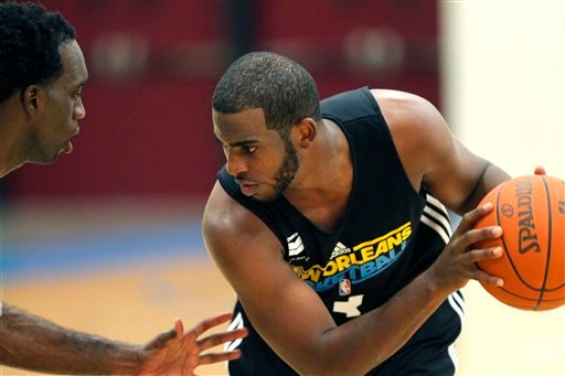 New Orleans Hornets guard Chris Paul, right, works out against Quincy Pondexter, left, during the first day of NBA basketball training camp in Westwego, La., Friday, Dec. 9, 2011. (AP Photo/Gerald Herbert)