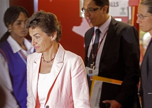 U.N. climate official Christiana Figueres walk out of the negotiation room as the climate change summit nears it's end in the city of Durban, South Africa, Saturday, Dec 10, 2011. (AP)
