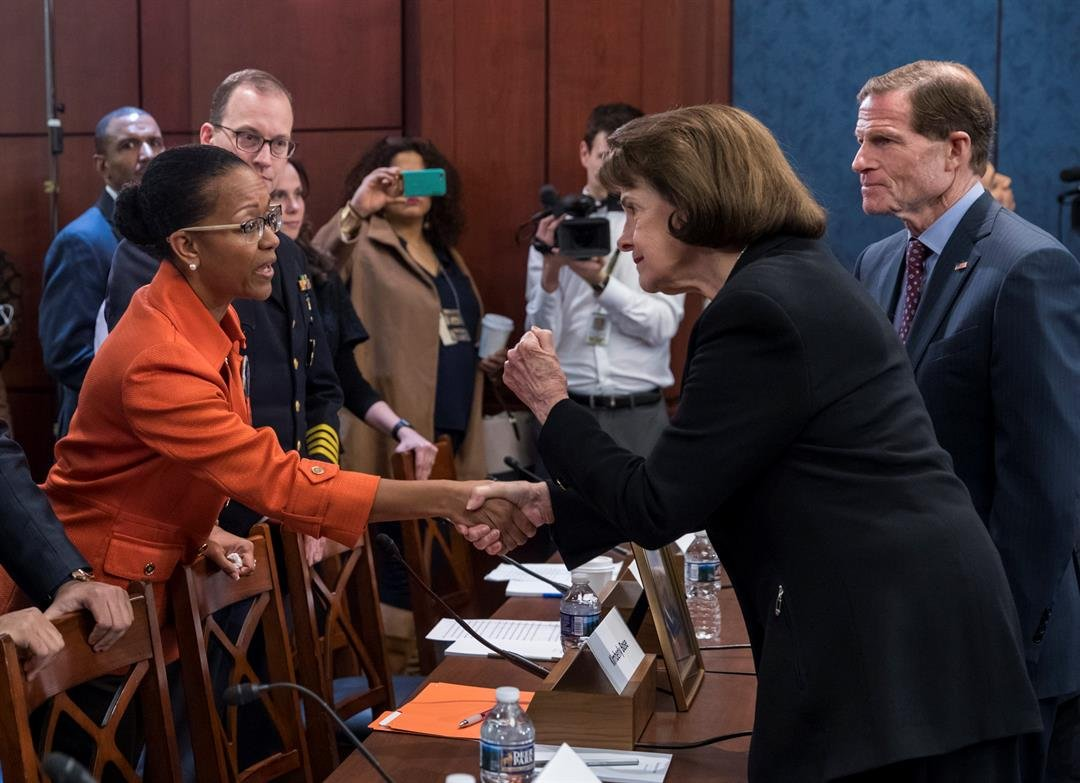 Kimberly Bose, of Alexandria, Va., whose son Joseph Bose was killed by gun violence in 2015, is greeted by Sen. Dianne Feinstein, D-Calif., and Sen. Richard Blumenthal, D-Conn. (AP Photo/J. Scott Applewhite)