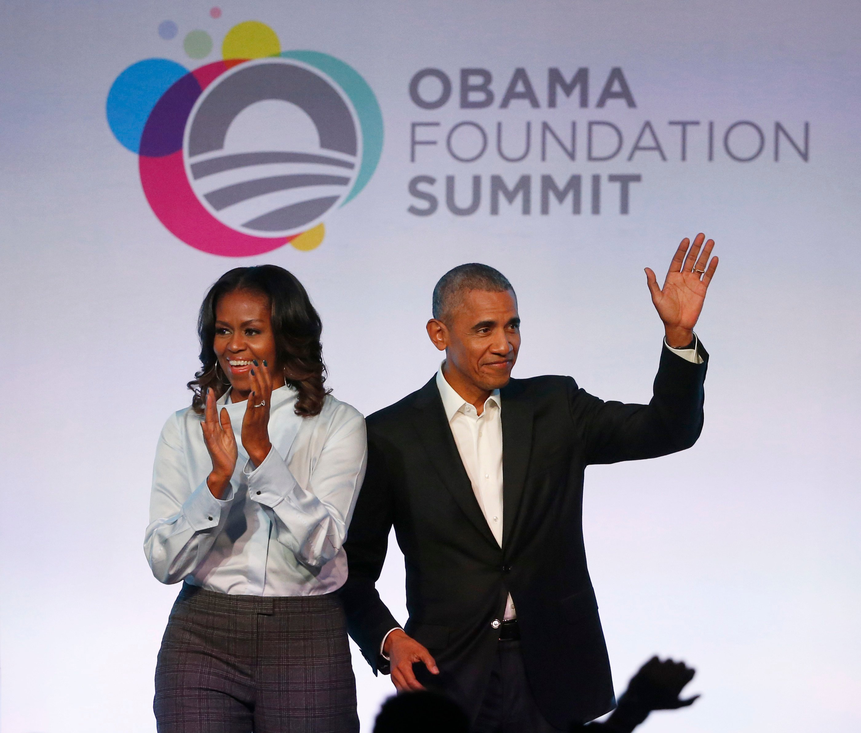 Former President Barack Obama, right, and former first lady Michelle Obama arrive for the first session of the Obama Foundation Summit in Chicago.
