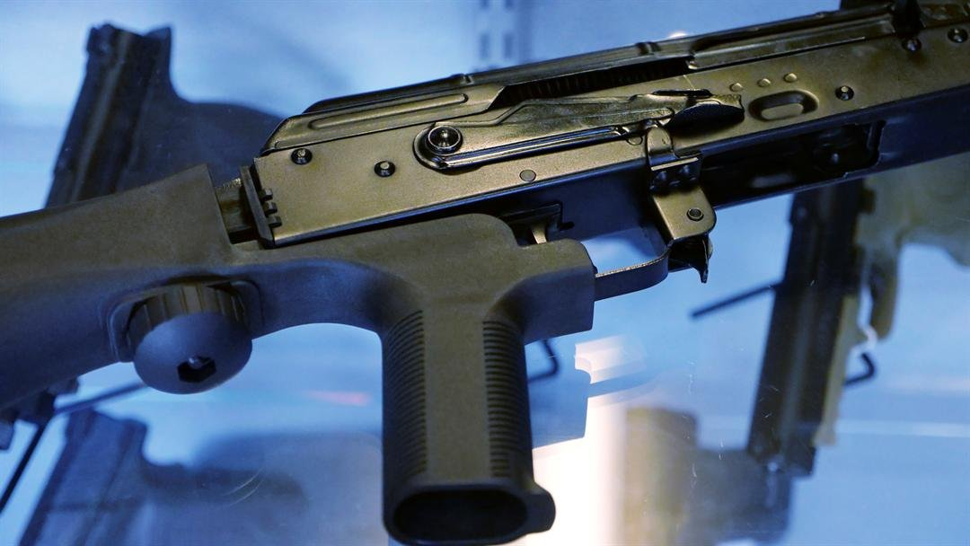 "In this Oct. 4, 2017, photo, a device called a ""bump stock"" is attached to a semi-automatic rifle at the Gun Vault store and shooting range in South Jordan, Utah. (AP Photo/Rick Bowmer)"