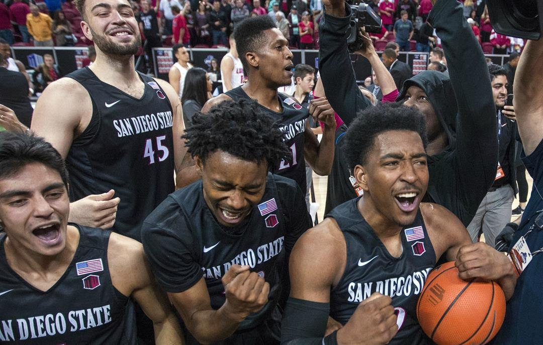 San Diego State players celebrate an 82-75 win over New Mexico in an NCAA college basketball game for the championship of the Mountain West Conference men's tournament Saturday, March 10, 2018, in Las Vegas. (AP Photo/L.E. Baskow)