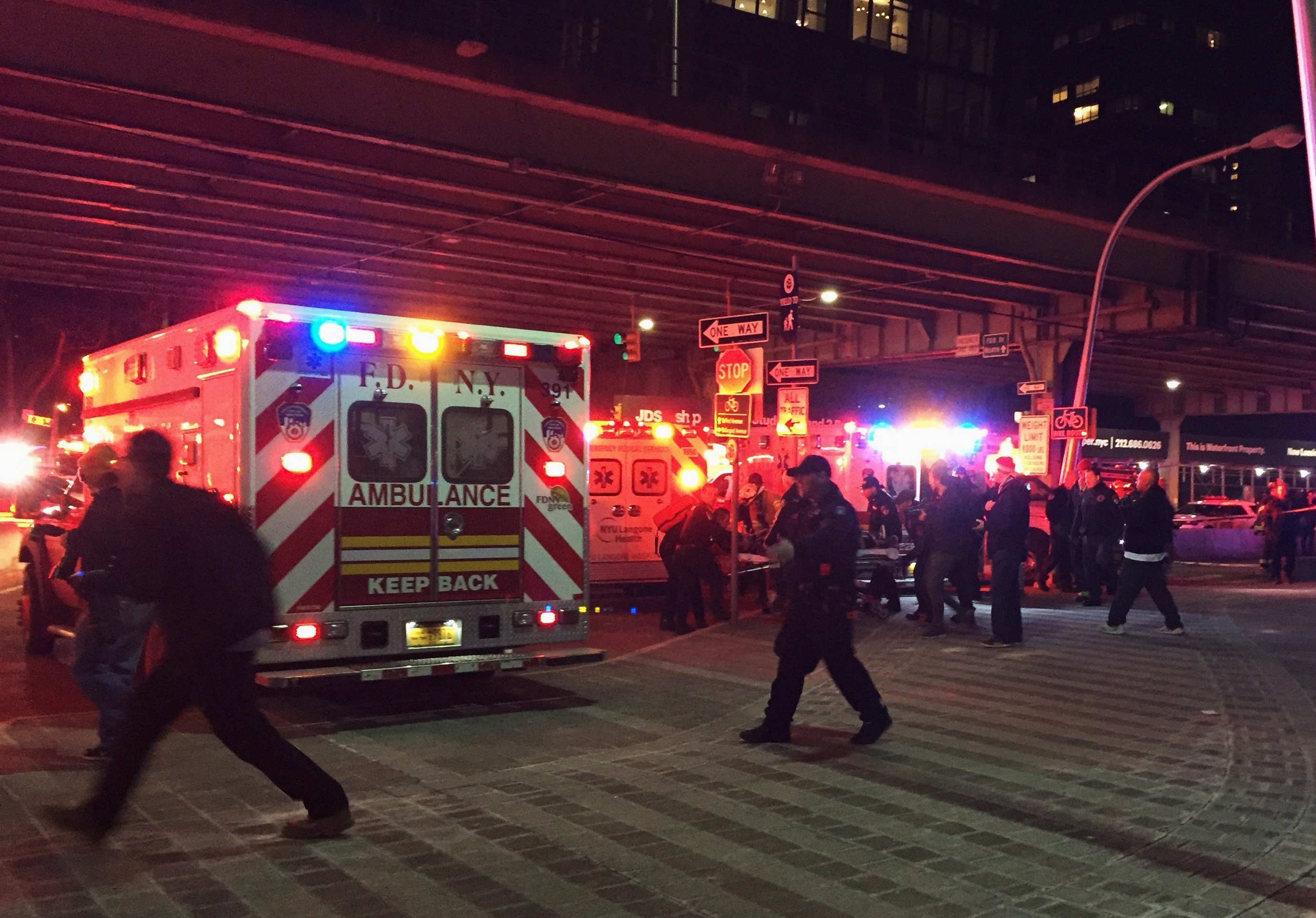 First responders carry a person to an ambulance after a helicopter crashed into the East River along New York on Sunday, March 11, 2018. (AP Photo/Jennifer Peltz)