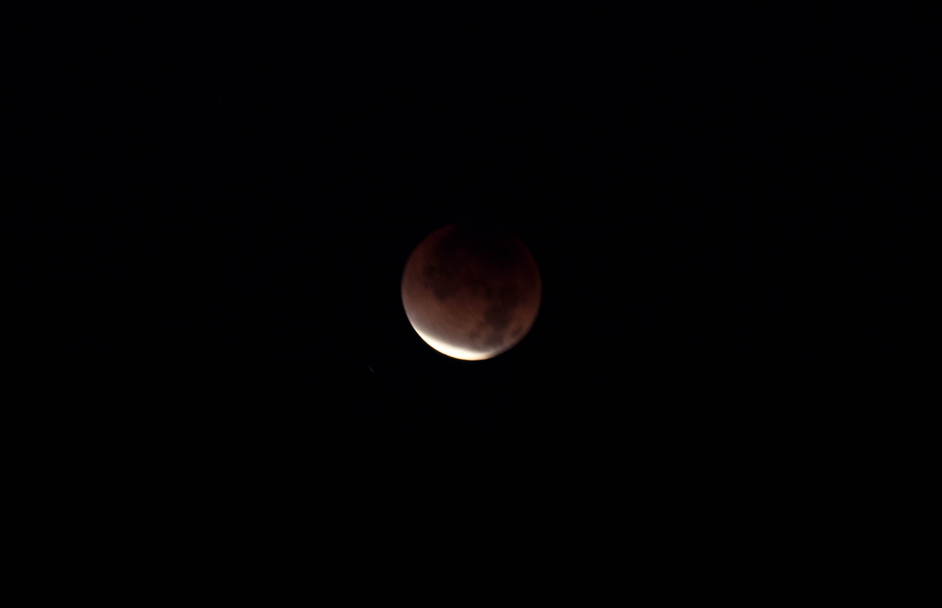 """Photo submission by KFMB viewer, Jen. """"Breaking Dawn of Red Lunar Eclpise"""""""