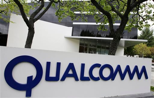 In this April 18, 2011 file photo, the corporate sign of Qualcomm Inc. is seen in front of its office in Santa Clara, Calif.  (AP Photo/Paul Sakuma, File)
