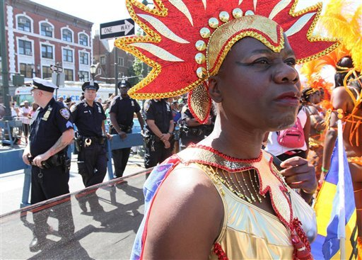 In this Sept. 26, 2010 photo, police stand along the route of the West Indian-American Day Parade as parade participants make their way along Eastern Parkway in the Brooklyn borough of New York. (AP)