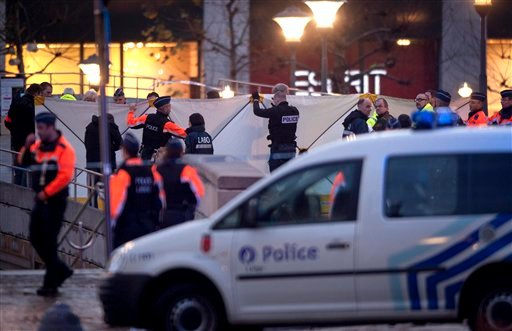 Police block the street in downtown Liege, Belgium, Tuesday Dec. 13, 2011, following a grenade attack in the city center, Tuesday, Dec. 13, 2011.  (AP photo/dapd/ Timur Emek)