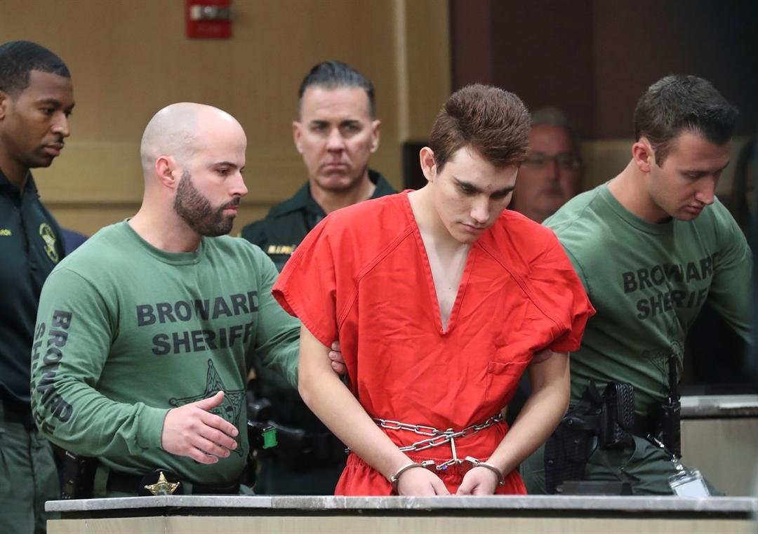 Nikolas Cruz is lead into the courtroom before being arraigned at the Broward County Courthouse in Fort Lauderdale, Fla., on Wednesday, March 14, 2018.