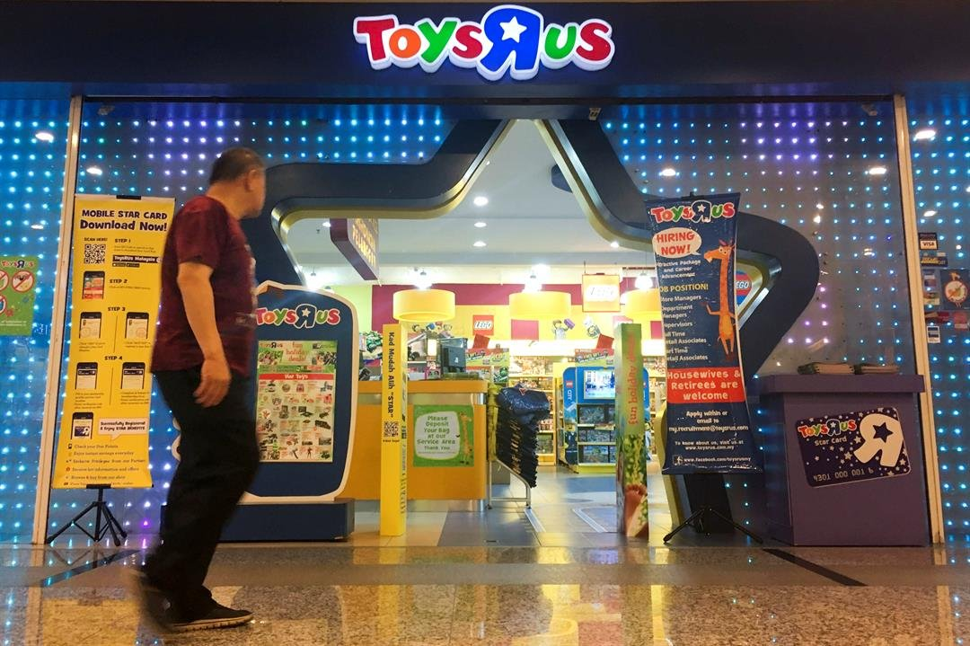 A man walks in front of the Toys R Us store at a shopping mall in Subang Jaya, Malaysia, Thursday, March 15, 2018.