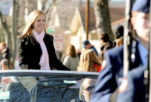 Jessica Lynch, who shot to fame as a POW during the Iraq war in 2003, is featured in the South Charleston, W.Va. Christmas Parade Saturday, Dec. 10, 2011. (AP Photo/Bob Bird)