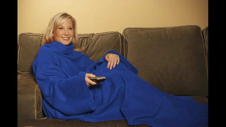 "In this product image provided by Allstar Products Group, a ""Snuggie"" is modeled. (Photo by Allstar Products Group, AP)"