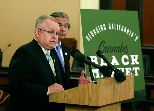 Assemblyman Tom Lackey, R-Palmdale, discusses the measure he and Assemblyman Rob Bonta, D-Oakland, right, are proposing to cut taxes on legal marijuana, Thursday, March 15, 2018, in Sacramento, Calif.