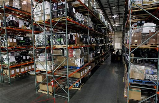 In this Dec. 8, 2011 photo, shelves in a warehouse are stacked with returned merchandise at Liquidity Services in Cranbury, N.J. (AP Photo/Mel Evans)