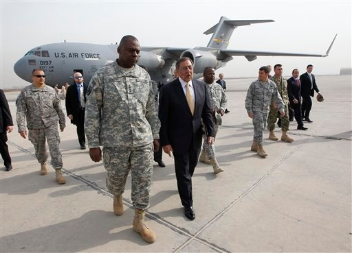 US Sec. of Defense Leon Panetta, right, walks across tarmac with Army Gen. Lloyd Austin, left, Commander of US Forces Iraq, during his arrival at Baghdad, Iraq, Thursday, Dec., 15, 2011. (AP Photo/Pablo Martinez Monsivais, Pool)