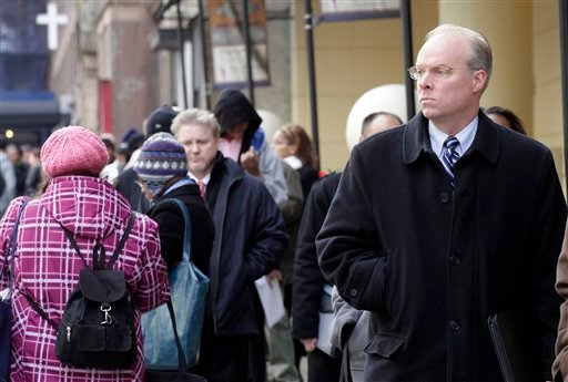 In this Dec. 12, 2011 photo, Stephen Rutkowski, a chiropractor from Greenwich, Conn., waits in line to attend a job fair sponsored by National Career Fairs, in New York. (AP Photo/Mark Lennihan)