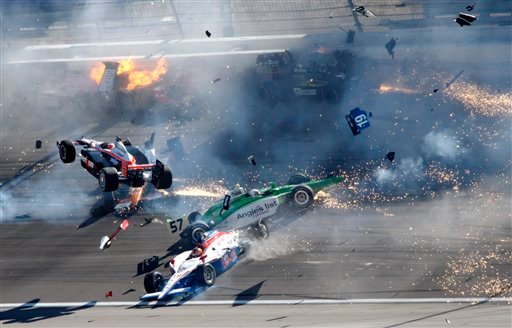 FILE -In this Oct. 16, 2011 file photo, Drivers crash during a wreck that involved 15 cars during the IndyCar Series' auto race at Las Vegas Motor Speedway in Las Vegas. (AP Photo/Las Vegas Review-Journal, Jessica Ebelhar)