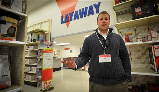 Kmart store manager Ted Straub talks Thursday Dec 15, 2011 in his Omaha, Neb store. Dozens of Kmart customers across the country have had their layaways paid off by strangers. (AP Photo/Dave Weaver)