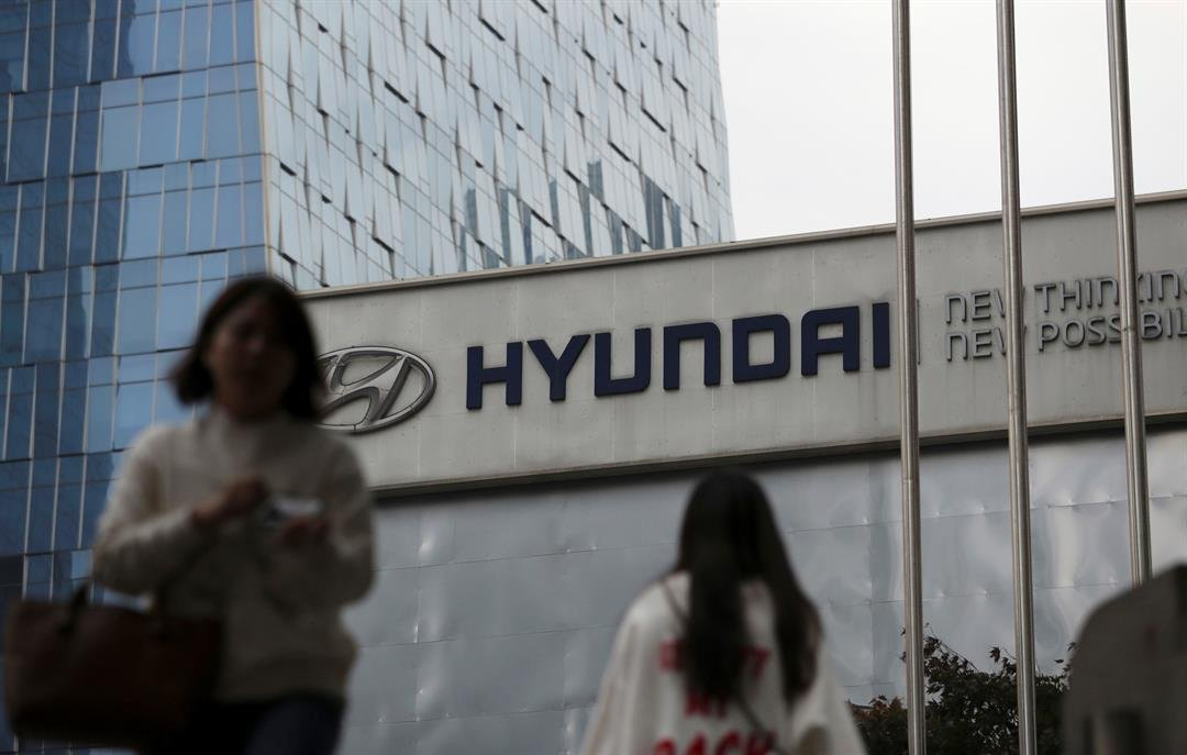 FILE - In this April 26, 2017, file photo, the logo of the Hyundai Motor Co. is displayed at the automaker's showroom in Seoul, South Korea. Air bags in some Hyundai and Kia cars failed to inflate in crashes and 4 people are dead. (AP Photo/Lee Jin-man)