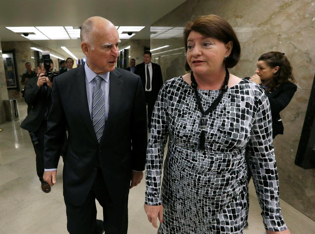 In this March 19, 2015 file photo Gov. Jerry Brown and Assembly Speaker Toni Atkins, of San Diego return to Brown's office after a news conference in Sacramento, Calif. (AP Photo/Rich Pedroncelli, File)