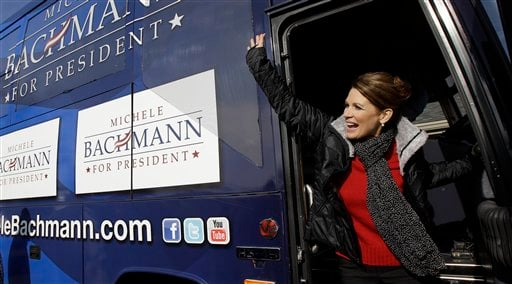 Republican presidential candidate, Rep. Michele Bachmann, R-Minn, waves from her bus during a campaign stop at the Family Table Restaurant, Friday, Dec. 16, 2011, in Le Mars, Iowa. (AP Photo/Eric Gay)