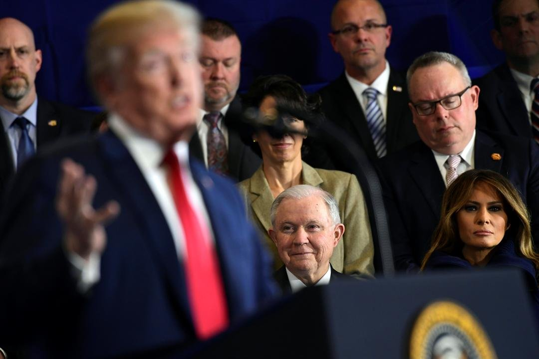 Trump Download Comp  Tag as... Cancel Apply Back to search results5of1,937 results TRUMP Overview Download now   Attorney General Jeff Sessions and first lady Melania Trump listen as President Donald Trump speaks at Manchester Community College.