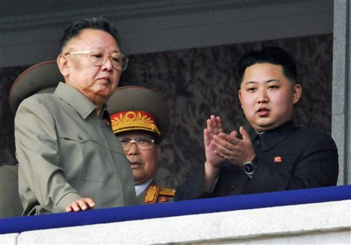 FILE - In this Oct. 10, 2010 file photo Kim Jong Un, right, along with his father and North Korea leader Kim Jong Il, left, attends during a massive military parade marking the 65th anniversary of the ruling Workers' Party in Pyongyang, North Korea.