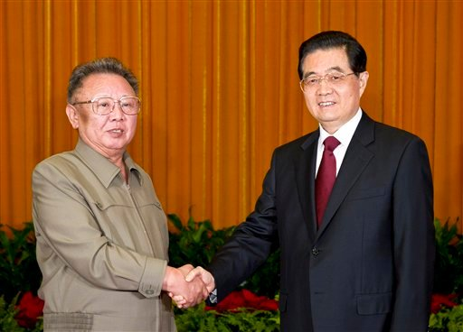 In this May 25, 2011 file p hoto released by China's Xinhua news agency, North Korean leader Kim Jong Il, left, shakes hands with Chinese President Hu Jintao during a meeting in Beijing. (AP)