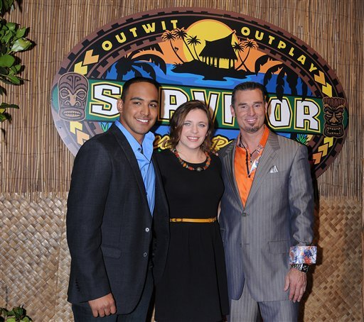 """Albert Destrade, left, Sophie Clarke and Benjamin 'Coach' Wade, right, arrive at the """"Survivor: South Pacific"""" finale and reunion show held at CBS Television City on stage 46 on Dec. 18, 2011 in Los Angeles, Calif."""