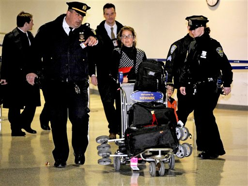 Lori Berenson, center, gets into a car with her son Salvador Apari at Newark Liberty International Airport, Tuesday, Dec. 20, 2011 in Newark, New Jersey. (AP)
