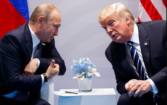 U.S. President Donald Trump, right, meets with Russian President Vladimir Putin at the G-20 Summit in Hamburg, Germany.