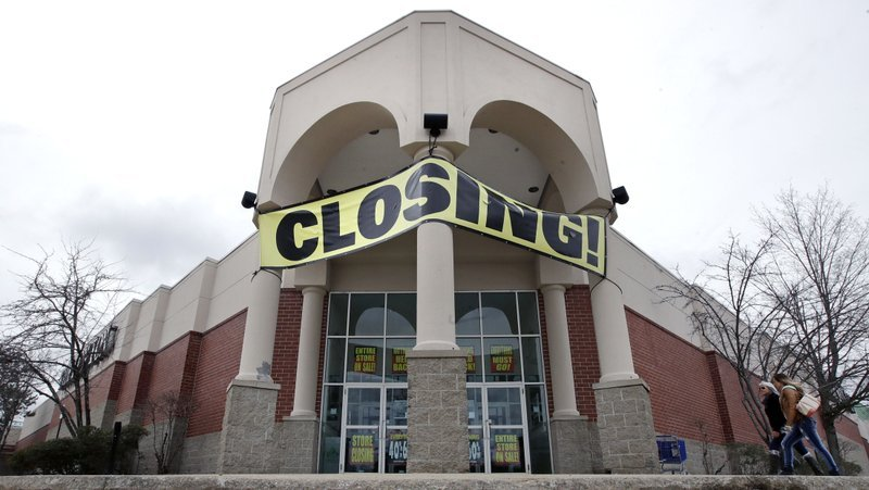 In this Feb. 23, 2018, file photo, customers enter a Bon Ton store, which is scheduled to close, in Concord, N.H.