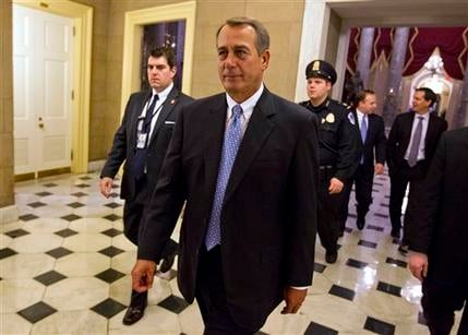House Speaker John Boehner of Ohio walks of the floor of the House chamber on Tuesday, Dec. 20, 2011, in Washington. (AP Photo/Evan Vucci)