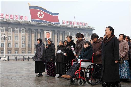 People wait to mourn the death of North Korea's leader Kim Jong Il in Pyongyang, North Korea, Wednesday, Dec. 21, 2011. (AP Photo/Xinhua, Zhang Li)