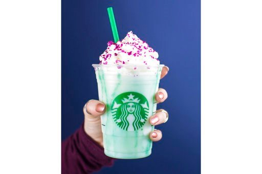 In this undated photo released by Edelman, U.S. Starbucks Coffee Company displays a new Crystal Ball Frappuccino Purple beverage. (Courtesy of Edelman via AP)