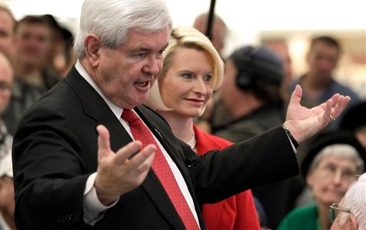 Republican presidential candidate former House Speaker Newt Gingrich, with his wife Callista, speaks at a Hy-Vee store in Mt. Pleasant, Iowa, Tuesday, Dec. 20, 2011. (AP Photo/Charlie Riedel)