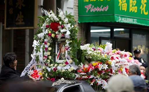 FILE - In a Thursday, Oct. 13, 2011 file photo, a portrait of Pvt. Danny Chen is displayed on a vehicle during his funeral procession in New York. (AP Photo/Jin Lee, File)